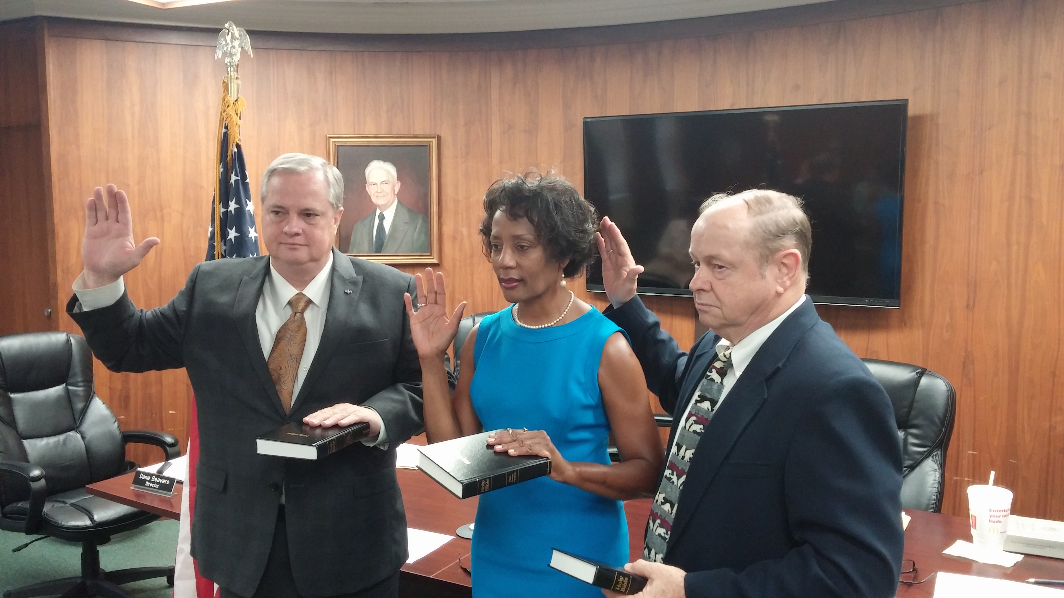 3 members of the Board of Elections being sworn into office.
